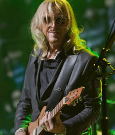 Davey Johnstone onstage with the Elton John Band