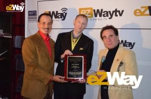 Jarvee Hutchinson, Eric Zuley, awarding Steve Resnik